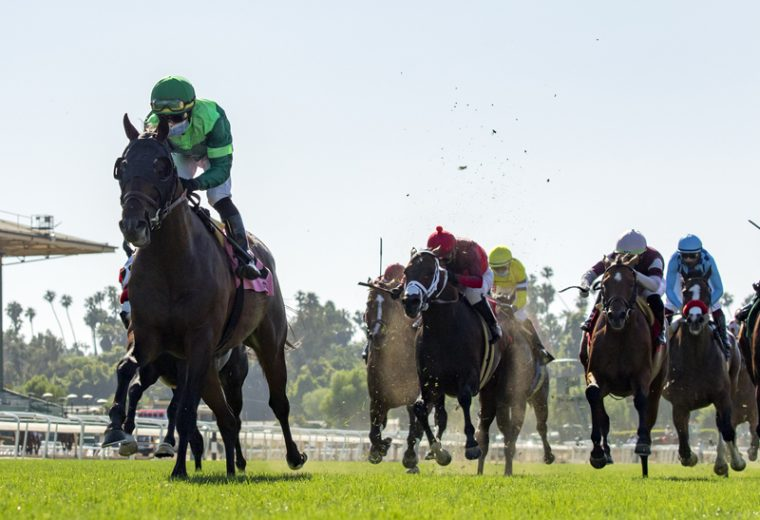 Peter M. Brant's Raging Bull and jockey Joel Rosario, left, win the Grade I, $300,000 Shoemaker Mile, Monday, May 25, 2020 at Santa Anita Park, Arcadia CA. © BENOIT PHOTO